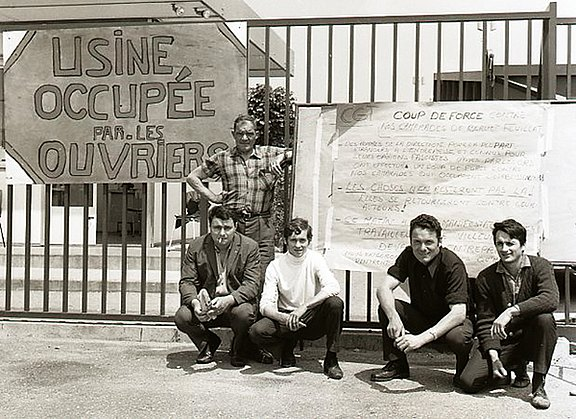 French_workers_with_placard_during_occupation_of_their_factory_1968.jpg